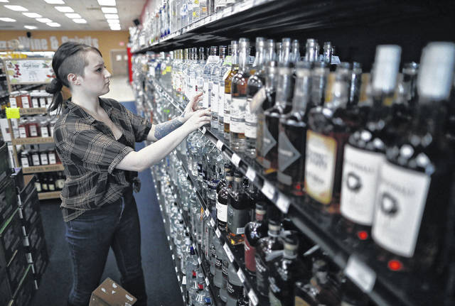 Lensey Cantrell stocks the shelf Thursday with Ketel One Vodka at Chateau Wine & Spirits in Dublin, Ohio.