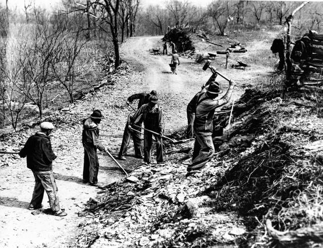FILE - In this March 9, 1936, file photo Works Progress Administration (WPA) workers build a new farm-to-market road along Knob Creek in Tennessee. The New Deal was a try-anything moment during the Great Depression that remade the role of the federal government in American life.