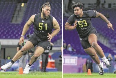 Jedrick Wills out of Alabama, left, and Tristan Wirfs out of Iowa run drills during February NFL scouting combine in Indianapolis. The Cleveland Browns may take either offensive tackle with the No. 10 overall pick in this year's NFL draft.