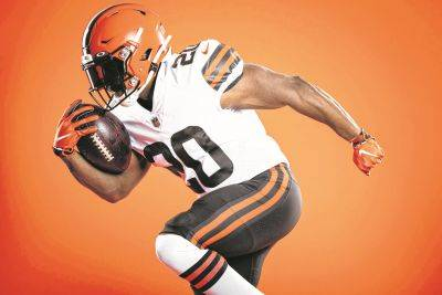 With a salute to their championship past, the Cleveland Browns unveiled new uniforms Wednesday.