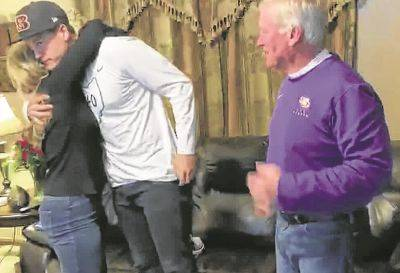 Joe Burrow celebrates with his parents, Robin and Jim, in The Plains after being chosen first overall by the Cincinnati Bengals during Thursday night's NFL draft.