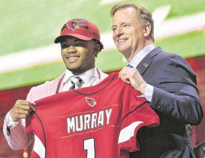 Oklahoma quarterback Kyler Murray, left, stands on stage next NFL Commissioner Roger Goodell after being drafted by the Arizona Cardinals No. 1 overall during the 2019 NFL draft in Nashville, Tenn. Goodell will introduce first-round picks from his home in Bronxville, New York, due to the COVID-19 pandemic.