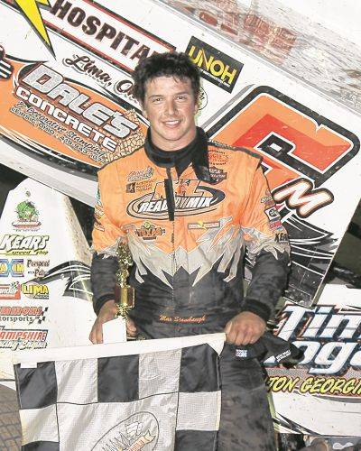 Max Stambaugh, shown here after winning a race in 2019, is optimistic the driving season will open last this year.