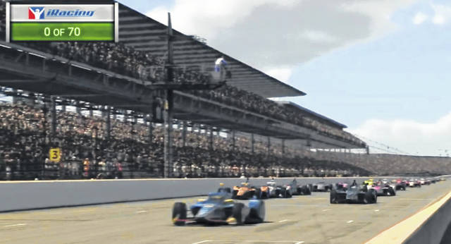 A car driven by Scott McLaughlin, left, leads the field at the green flag during the First Responder 175 presented by GMR virtual IndyCar race Saturday at the Indianapolis Motor Speedway.