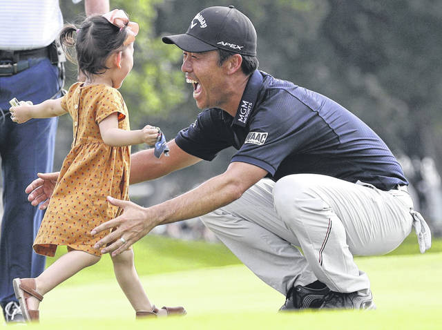 Kevin Na celebrates with his daughter Sophia after winning the Charles Schwab Challenge last year in Fort Worth, Texas. One of the changes the PGA Tour announced Wednesday when play resumes is no family members will be allowed to attend tournaments for at least a month, perhaps longer.