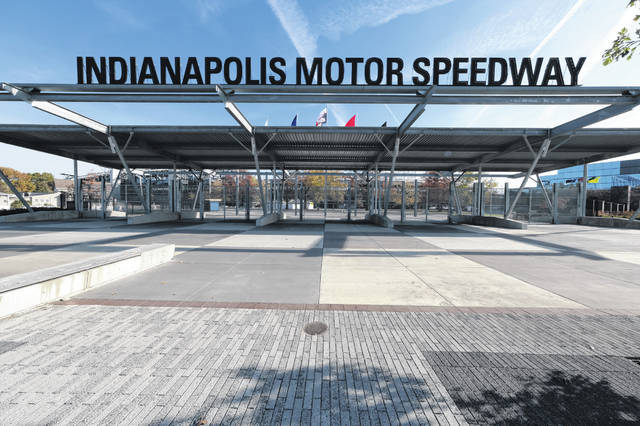 FILE - In this Nov. 4, 2019, file photo, Gate one at the Indianapolis Motor Speedway is shown before a news conference announcing the sale of the race track, IndyCar and related business from Hulman & Company to Penske Corporation in Indianapolis. It is finally May and acceptable to declare this a crummy year for Roger Penske to have purchased Indianapolis Motor Speedway.  (AP Photo/AJ Mast, File)