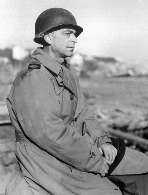 FILE - In this March 1, 1944 file photo, Edward Kennedy, Chief of the Associated Press staff in North Africa, wears a metal helmet at the Anzio beachhead in Italy. Kennedy, then AP's chief of bureau in Paris, was present at the surrender and was the first to report the end of the war in Europe to the United States and the world, bypassing the Allied political embargo. (AP Photo/Pool, File)