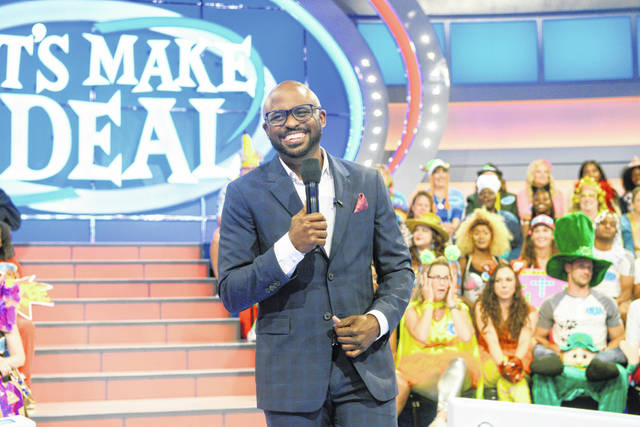 "This image released by CBS Entertainment shows Wayne Brady, host of the daytime game show ""Let's Make a Deal."" The CBS daytime game show that usually has a studio audience in zany costumes is asking front-line workers to submit a video audition for an upcoming special online edition of the show."