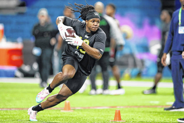 FILE - In this Feb. 28, 2020, file photo, Maryland running back Anthony McFarland runs a drill at the NFL football scouting combine in Indianapolis. Steelers rookie running back Anthony McFarland is doing Zoom meetings with coaches then heading outside to see if he's lining up in the right spots. Yeah, it's weird, but he and his fellow rookies are making due. (AP Photo/Charlie Neibergall, File)
