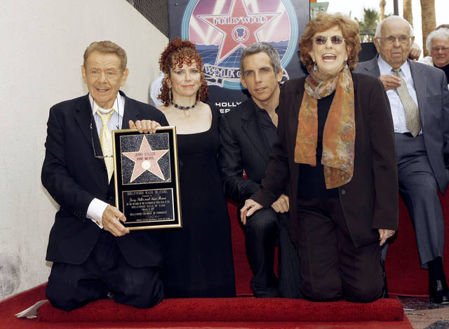 """FILE - In this Feb. 9, 2007, file photo, actors Jerry Stiller, far left, and Anne Meara, second from right, pose with their children, Ben Stiller and Amy Stiller as they are honored with a star of the Hollywood Walk of Fame in Los Angeles. Comedian veteran Stiller, who launched his career opposite wife Anne Meara in the 1950s and reemerged four decades later as the hysterically high-strung Frank Costanza on the smash television show """"Seinfeld,"""" died at 92, his son Ben Stiller announced Monday. Honorary Mayor of Hollywood, Johnny Grant is shown in background at right. (AP Photo/Damian Dovarganes, File)"""