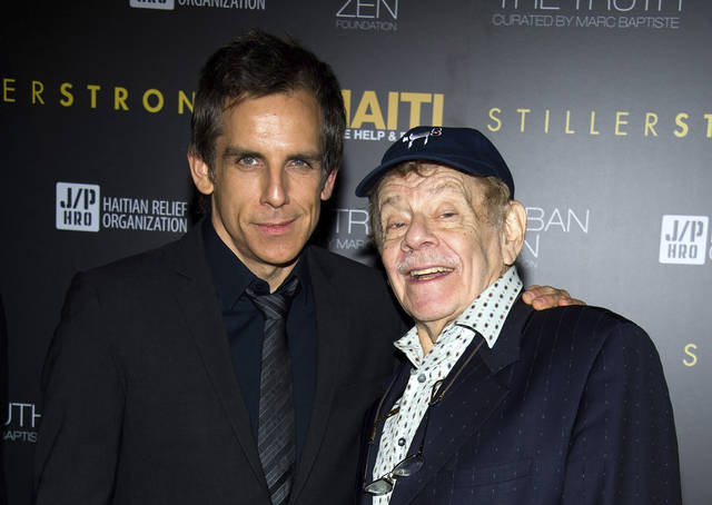 """In this Feb. 11, 2011, photo, Ben Stiller, left, and his father Jerry Stiller arrive at the Help Haiti benefit honoring Sean Penn hosted by the Stiller Foundation and The J/P Haitian Relief Organization, in New York. Comedian veteran Jerry Stiller, who launched his career opposite wife Anne Meara in the 1950s and reemerged four decades later as the hysterically high-strung Frank Costanza on the smash television show """"Seinfeld,"""" died at 92, his son Ben Stiller announced Monday. (AP Photo/Charles Sykes, File)"""
