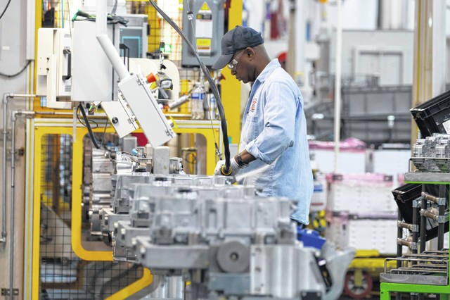 An autoworker assembles a transmission in May 2011 at the General Motors Transmission Plant in Toledo. Defying a wave of layoffs that has sent the U.S. job market into its worst catastrophe on record, at least one major industry is making a comeback: Tens of thousands of auto workers are returning to factories that have been shuttered since mid-March due to fears of spreading the coronavirus.