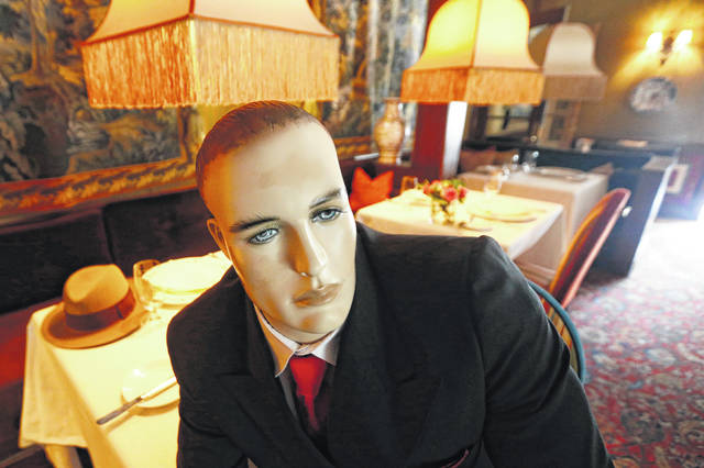 Mannequins provide social distancing at the Inn at Little Washington as they prepare to reopen their restaurant in Washington, Va. The manager said every-other table will have mannequins for social distance guidance when, according to state guidelines, the five-star restaurant will be allowed reopen on May 29th.