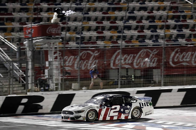 Brad Keselowski wins the NASCAR Cup Series auto race at Charlotte Motor Speedway early Monday, May 25, 2020, in Concord, N.C. (AP Photo/Gerry Broome)