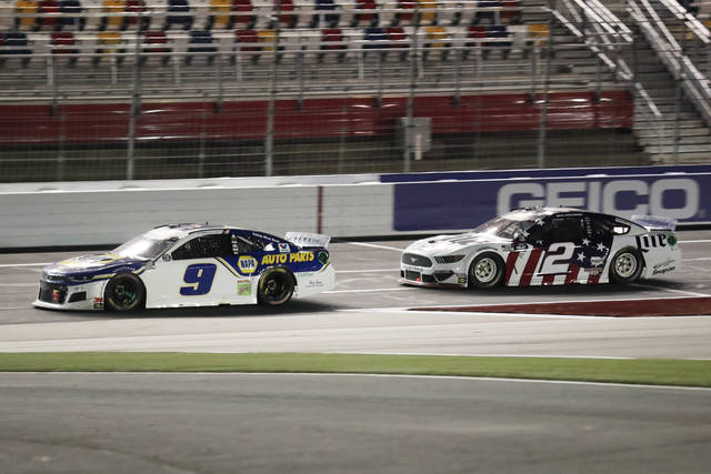 Chase Elliott (9) leads Brad Keselowski (2) during a NASCAR Cup Series auto race at Charlotte Motor Speedway Sunday, May 24, 2020, in Concord, N.C. (AP Photo/Gerry Broome)