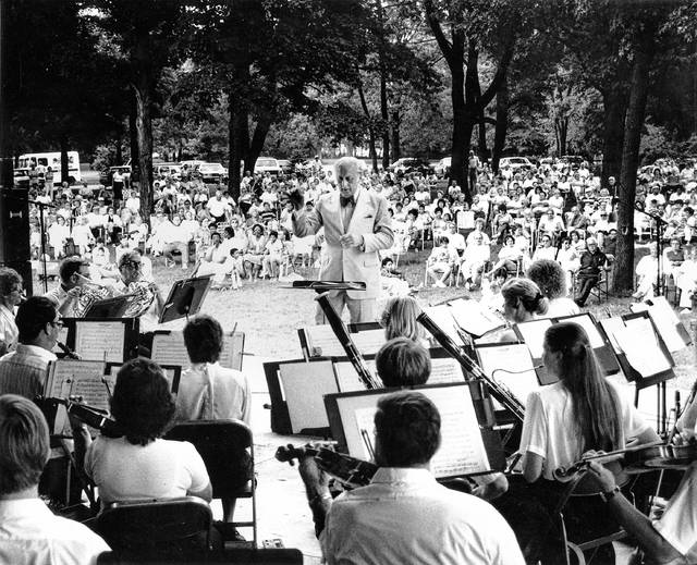 Joseph Firszt conducts the orchestra at a concert in the park July 6, 1986.