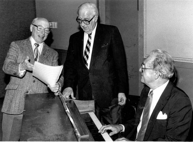 Firszt reviews music with Harold Beckett and Richard Riggs in September 1991.