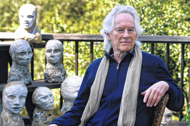 FILE - In this Sept. 16, 2010, file photo, beat poet Michael McClure is seen on his deck with sculptures by his wife, artist Amy Evans McClure, at their home in Oakland, Calif. Michael McClure, one of the famed Beat poets of San Francisco who went on a career as a poet that eclipsed most others in popular culture, has died. The San Francisco Chronicle reported that McClure died Tuesday, May 5, 2020, in Oakland, Calif., after suffering a stroke last year. He was 87.
