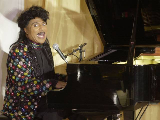 "FILE - In this July 22, 2001 file photo, Little Richard performs at the 93rd birthday and 88th year in show business gala celebration for Milton Berle, in Beverly Hills, Calif. Little Richard, the self-proclaimed ""architect of rock 'n' roll"" whose piercing wail, pounding piano and towering pompadour irrevocably altered popular music while introducing black R&B to white America, has died Saturday, May 9, 2020."