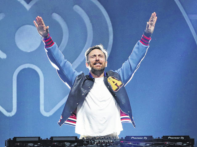 FILE - This Sept. 22, 2017 file photo shows DJ-producer David Guetta performing at the 2017 iHeartRadio Music Festival in Las Vegas. When hundreds of artists started singing from their living rooms when the coronavirus pandemic hit, the Grammy-winning DJ-producer still wanted to perform in front of a live audience. So the hitmaker set up shop at Icon Brickell in downtown Miami, performing outdoors for 90 minutes as 8,000 locals danced along from their balconies during the feel-good moment last month. Now, he's launching his second United At Home event at an undisclosed location in New York on Saturday to connect with fans and raise money for health care workers and virus relief efforts.