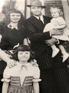 An early family photo depicts Barb Moore as a child (lower left). Her parents were Paul John and Margaret Clark.