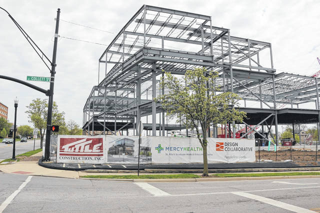 Tuttle Construction remains busy with projects at both Lima hospitals but is waiting for the business to pick up as decisions on other projects were put on hold.