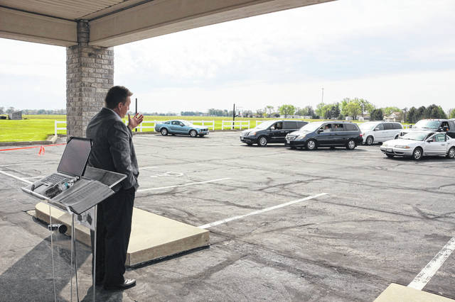 Pastor Ben Geiser conducted Sunday services in the parking lot of Faith Assembly of Believers Church in Ottawa.