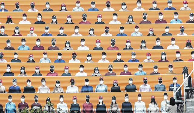 Cardboard cutouts of fans fill some of the seats for a game between the Hanwha Eagles, a Korean baseball team which Fort Loramie's Jared Hoying plays for, and the SK Wyverns in Incheon, South Korea. No fans are allowed at the games because of the coronavirus.