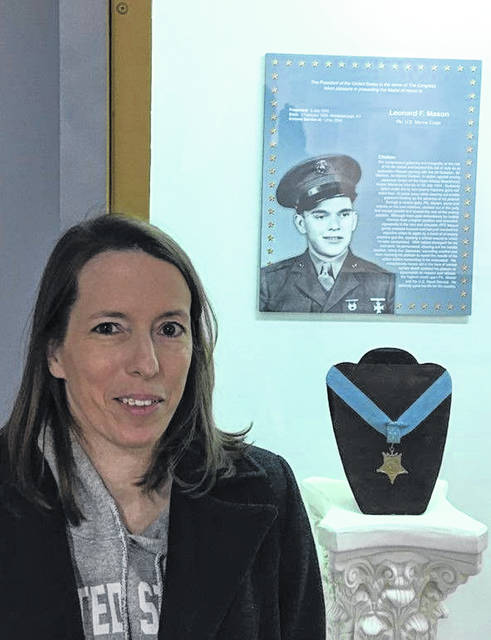Lori Americo visits the display of her great uncle, Leonard Mason of Lima, who is on the Roll of Honor at the Allen County Museum. Mason received the Medal of Honor for his heroic action during World War II. Landing on Guam in July of 1944, he cleared out hostile positions against heavy machine gun fire despite being mortally wounded.