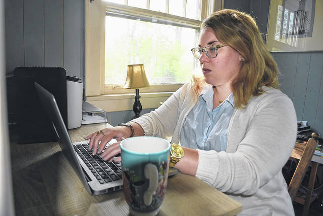 """Teachers had to rethink how they educated students, said Noel Cordle, English department chair at Lima Central Catholic High School. """"Taking some of the 'bells and whistles' out of the classroom experience has enabled me to look critically at what is most important in my curriculum, while also conceiving creative ways to convey these concepts digitally,"""" she said."""