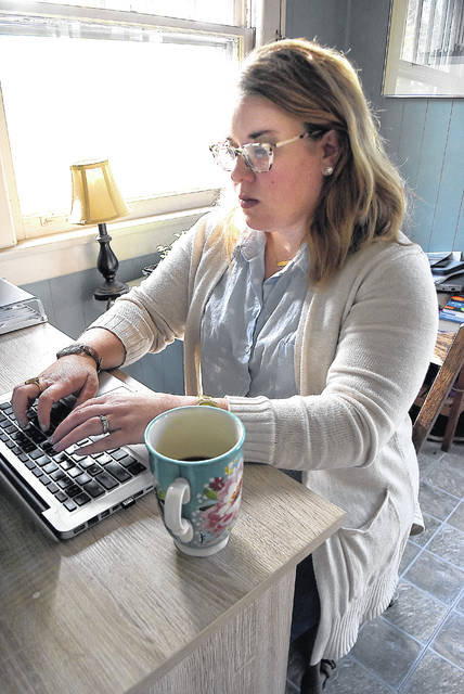 Noel Cordle, an English teacher at Lima Central Catholic High School, checks students' homework with her laptop while working at home in Lima. Teachers turned to Zoom, Loom, Screencastify, Facebook, Schoology, Google Classroom, Google Hangouts and Class Dojo to present lessons during the coronavirus pandemic.