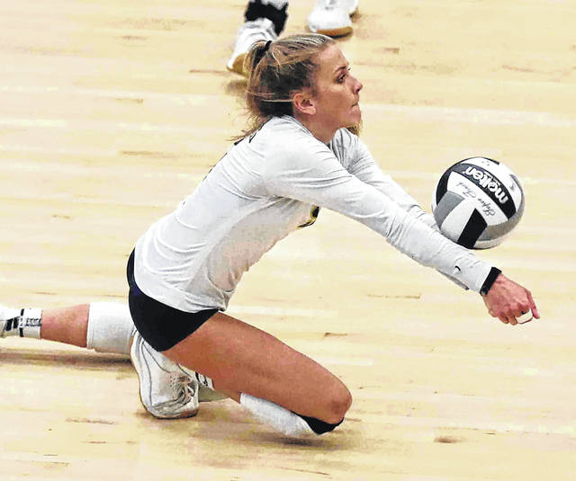 Ottawa-Glandorf's Claire Eiden, here diving to make a save during the Titans' 2019 Division III district final match against Fairview, has a 4.0 grade point average.