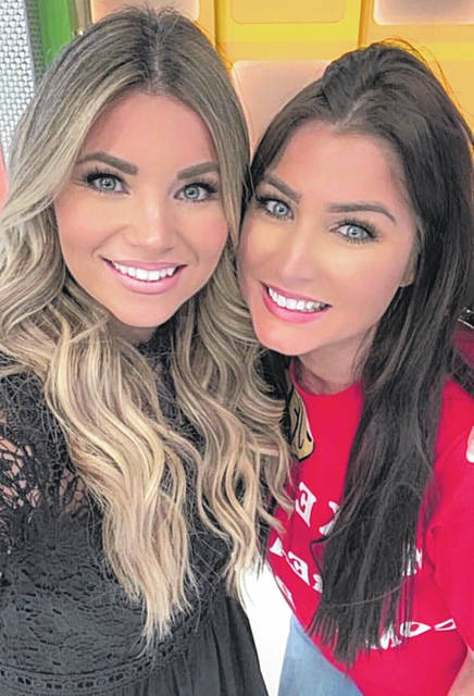 """Jenna Witham, right, takes a selfie with """"The Price is Right"""" model Amber Lancaster after winning the showcase on the show."""