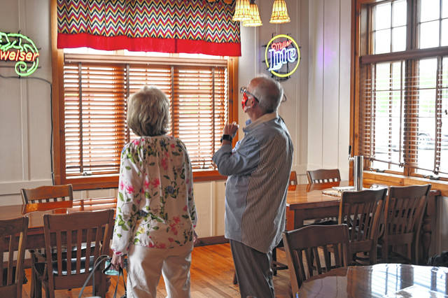 Paulette and Dick Schnipke, the longtime owners of the Red Pig Inn in Ottawa, marvel at the updates made by the new ownership group of the Putnam County restaurant known for its barbecue.