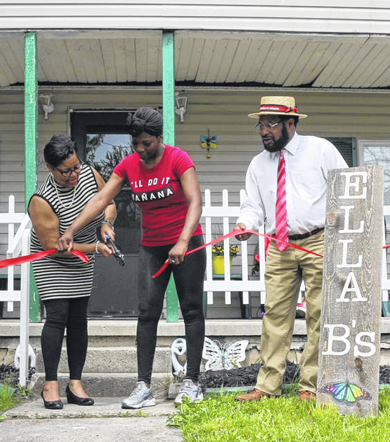Linda Scott, her daugher in law Shaleya Davis and Lima City Councilman Derry Glenn cut the ribbon on a home at 621 Michael Avenue. Ella B's group home will be used to house homeless people with mental health issues.