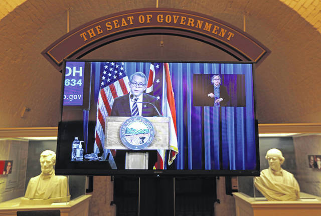 While at a remote location for security purposes, Ohio Gov. Mike DeWine answers a question about reopening Ohio during the coronavirus news conference on Thursday, May 14, 2020 at the Ohio Statehouse in Columbus, Ohio. The feed was shown in the Ohio Statehouse Crypt, or basement, where reporters are able to ask him questions.