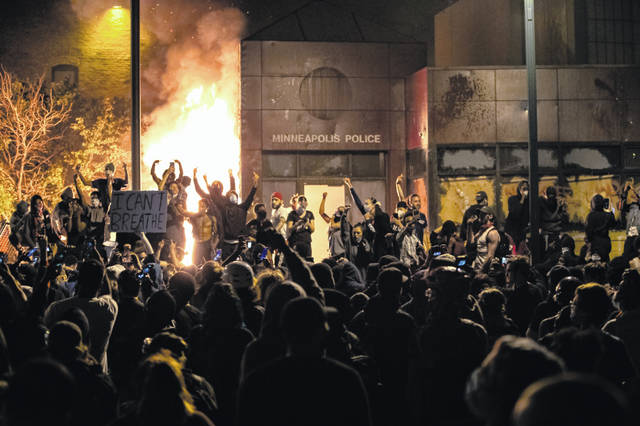 The Minneapolis Third Police Precinct is set on fire during a third night of protests following the death of George Floyd while in Minneapolis police custody, on Thursday.