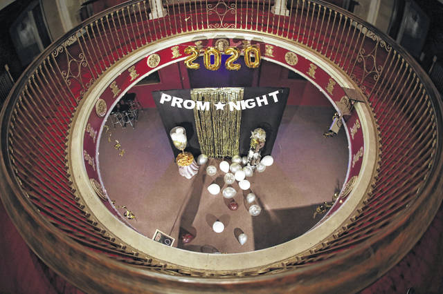 Decorations stand alone for atmosphere — no student photos this year —	at a virtual prom hosted by Phil Austin at the Ohio Theatre on Saturday evening.