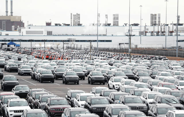 Jeep vehicles are parked outside the Jefferson North Assembly Plant in Detroit.
