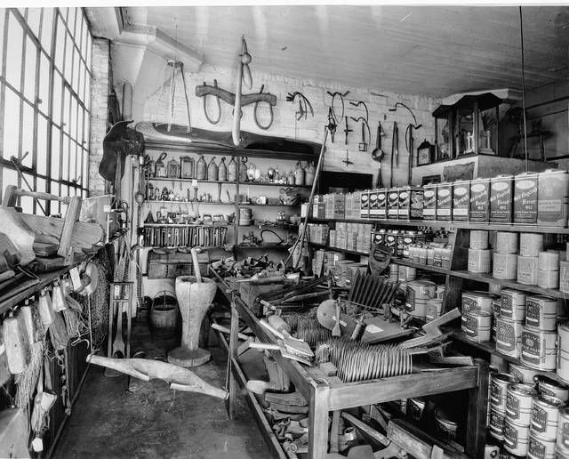 A photo from 1938 shows the interior of the Lewis Bros. lumber business.