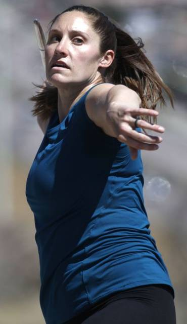Olympic javelin competitor Kara Winger trains outside her home in Colorado Springs, Colo. (AP photo)