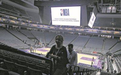 Fans leave the Golden 1 Center in Sacramento, Calif., on March 11 after the game between the New Orleans Pelicans and Sacramento Kings was called off as a precaution after a player for the Utah Jazz tested positive for the coronavirus.