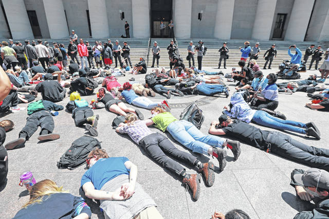 Protesters gather at the Ohio Statehouse for a peaceful protest Sunday.