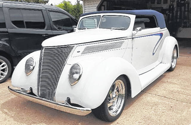 Talk about standing out in a crowd of cars, this 1937 Ford Cabriolet does that and more. It was purchased by Steve and Janet Bechtel, of Belle Center, recently from an estate sale in Florida.