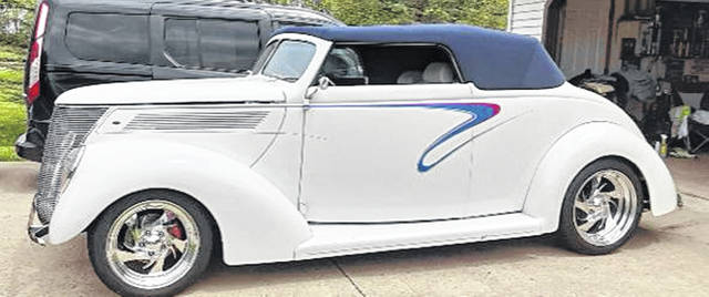 The 1937 Ford Cabriolet, owned by Steve and Janet Bechtel of Belle Center, is pearl white with a navy blue top. The interior is white and navy blue. It has only 13,752 miles on it.