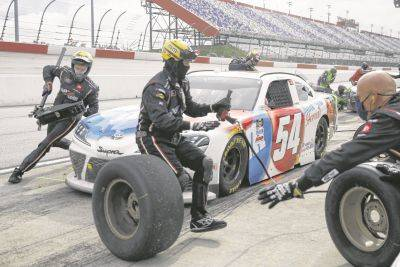 Kyle Busch makes a pit stop during Thursday's NASCAR Xfinity race in Darlington, S.C.