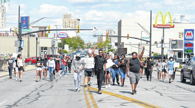 Protesters marched down West Market Street in downtown Lima on Saturday afternoon in honor of George Floyd, an unarmed black man who died after a white policeman kneeled on his neck for nearly eight minutes in Minneapolis, Minnesota.