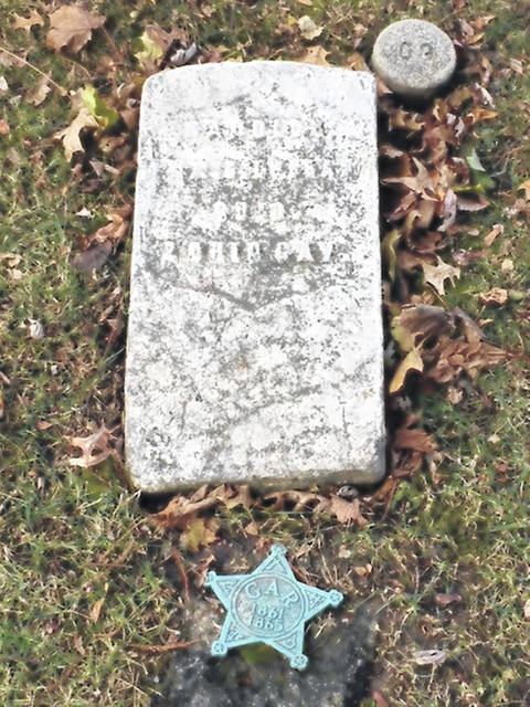 This mystery tombstone was found in Woodlawn Cemetery in Lima.