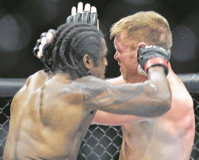 "Ryan ""Superman"" Spann, left, fights Sam Alvey during a UFC 249 bout Saturday night in Jacksonville, Fla. Spann (18-5) extended his winning streak to eight fights by beating Alvey (33-14) in a split decision."