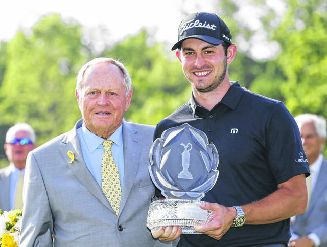 Host Jack Nicklaus, left, presents Patrick Cantlay with the trophy after Cantlay won the 2019 Memorial Tournament in Dublin. Due to the COVID-19 pandemic the event had to be pushed back to July 16-19 at Muirfield Village Golf Club.